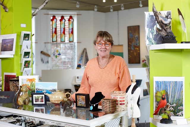 Penny Varney stands amoung many peices of art and handcrafted items created by local artist in the Arts at the Albion cooperative gallery in Downtown Gravenhurst