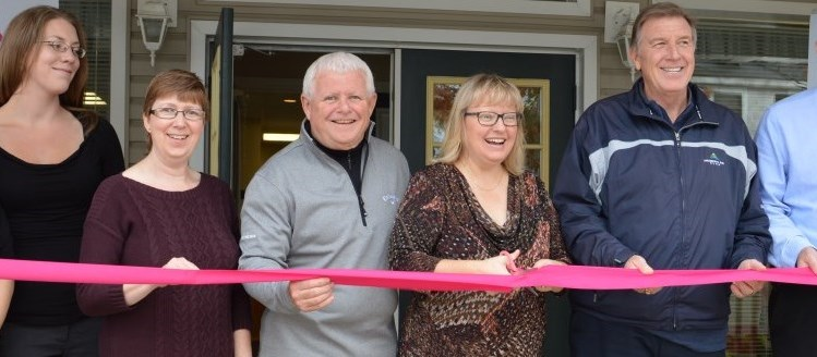 new business celebrates their grand opening with an official ribbon cutting