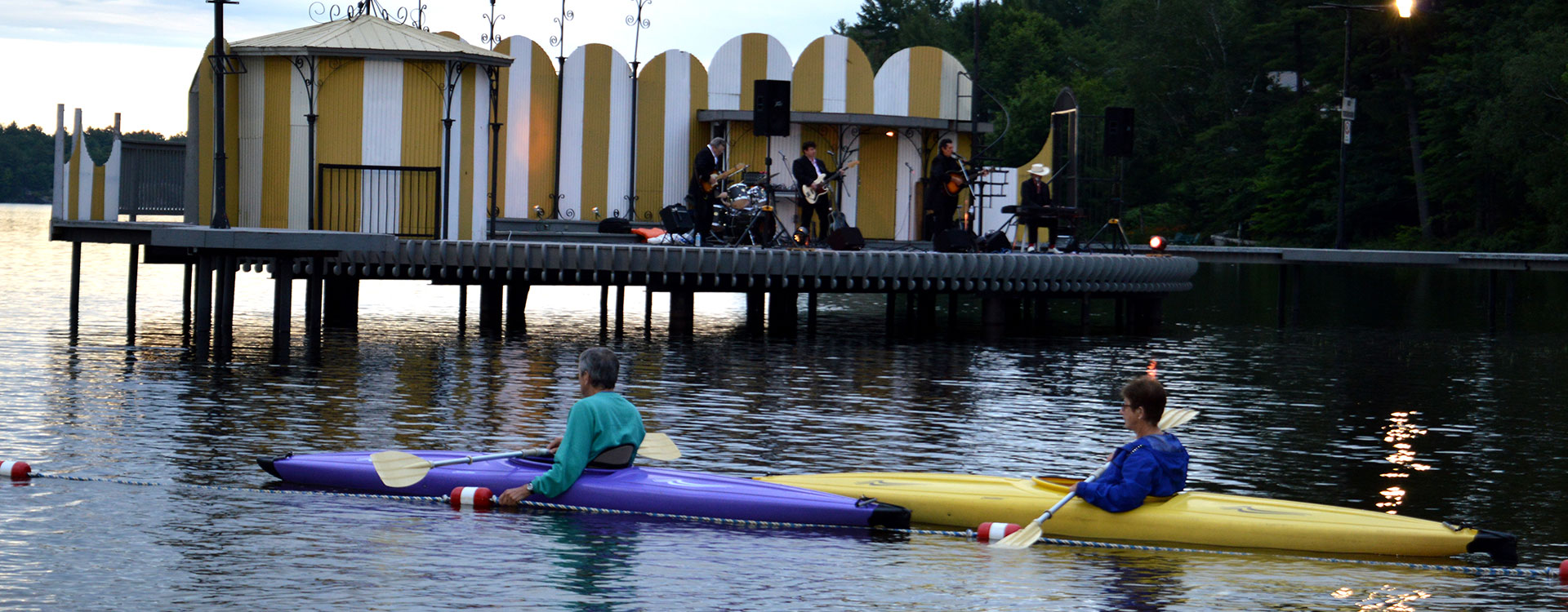 Kayaking on the water at Gull Lake Music on the Barge, Explore and Play