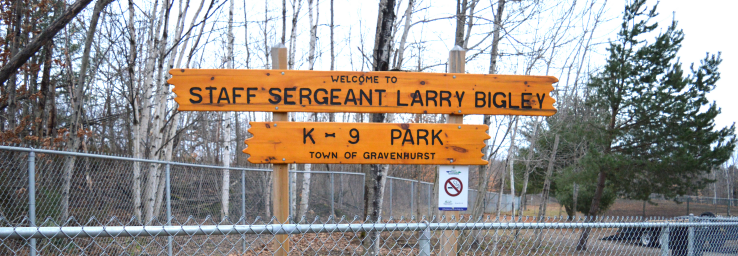 Wood sign Welcome to Staff Sergeant Larry Bigley K-9 Park