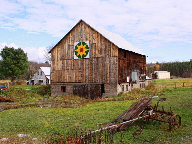 Photo of a stop on the Ryde Barn Quilt Trail; a barn exterior with the quilt on it