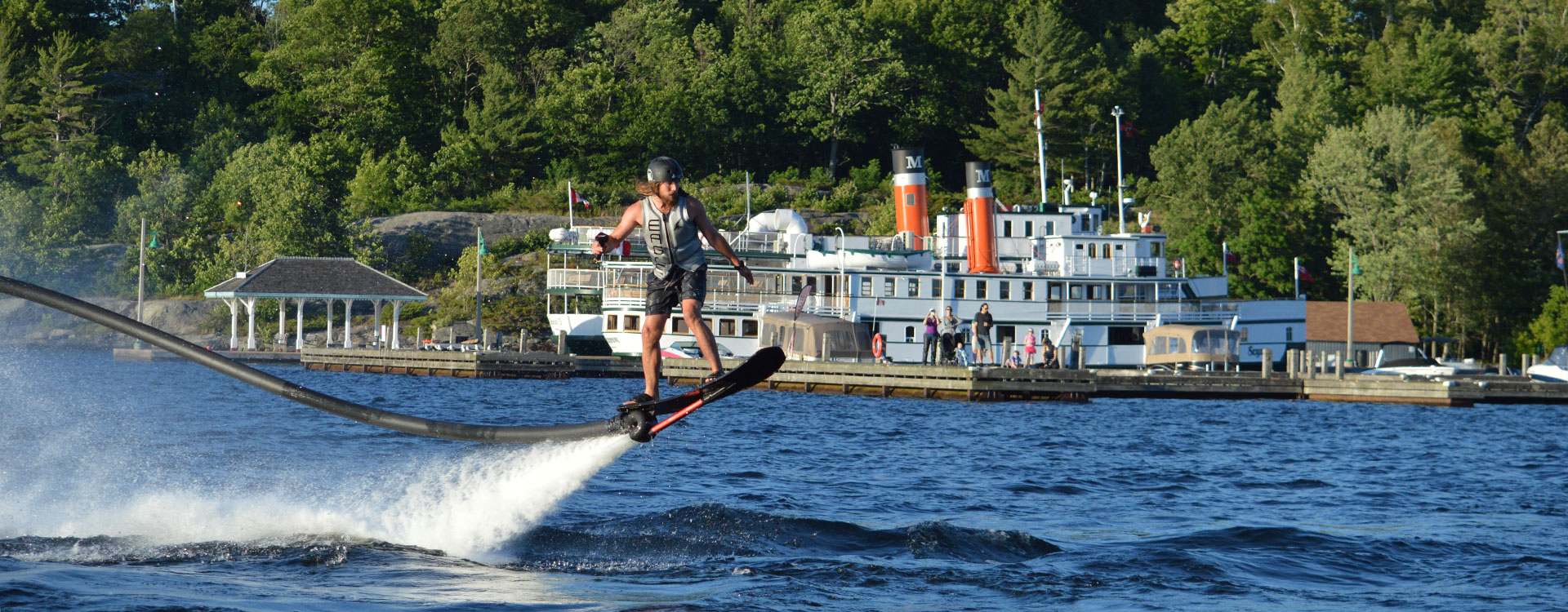 Water ski show, Muskoka Wharf, Lake Muskoka in front of Steamship