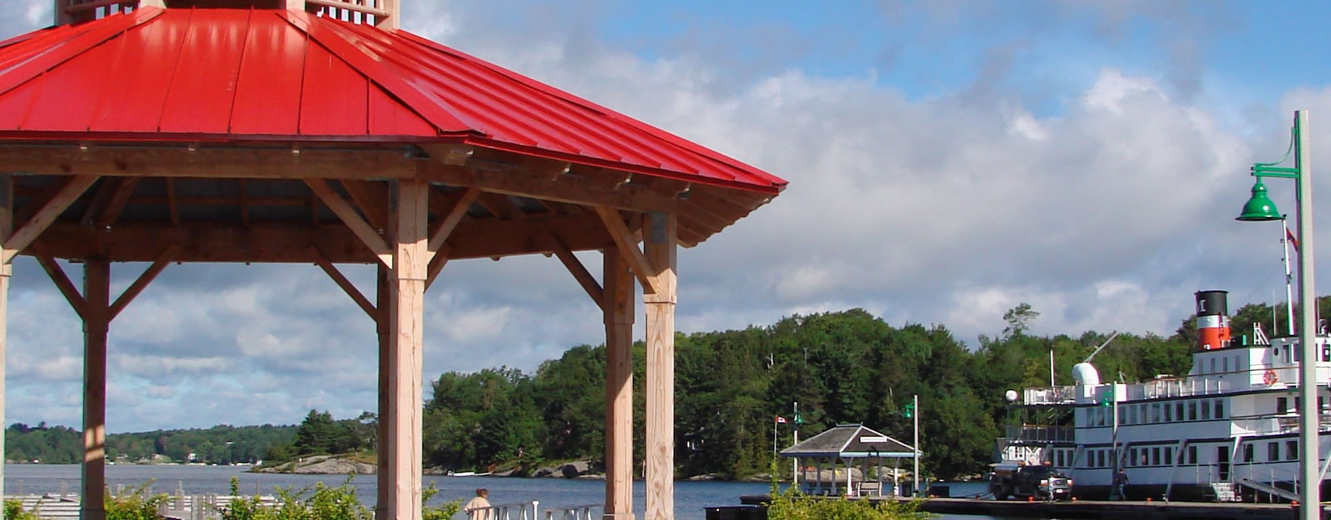 A.P. Cockburn Square, Large gazebo structure with red steel roof at Muskoka Wharf