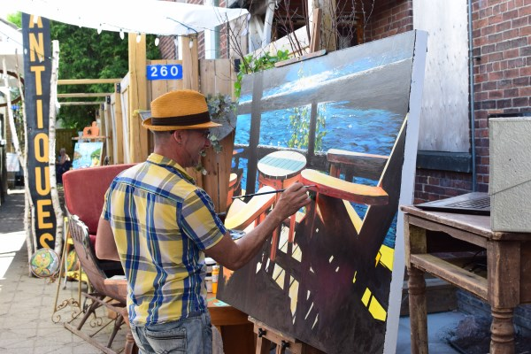 Man painting scenic image in Downtown Gravenhurst