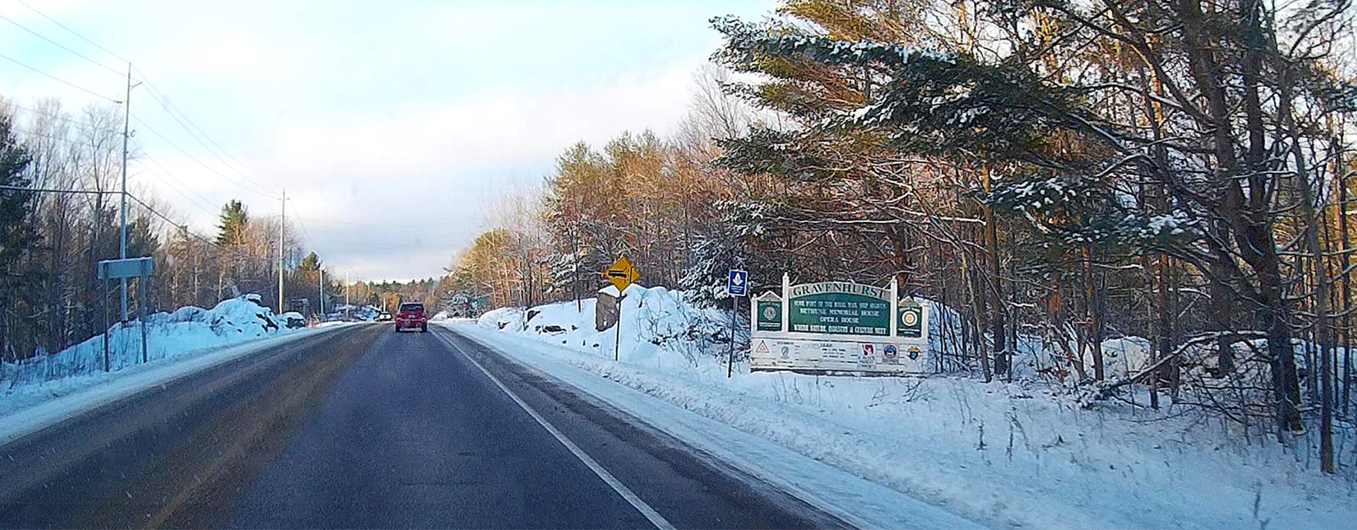 Bethune Drive, Winter, Town of Gravenhurst sign on the shoulder