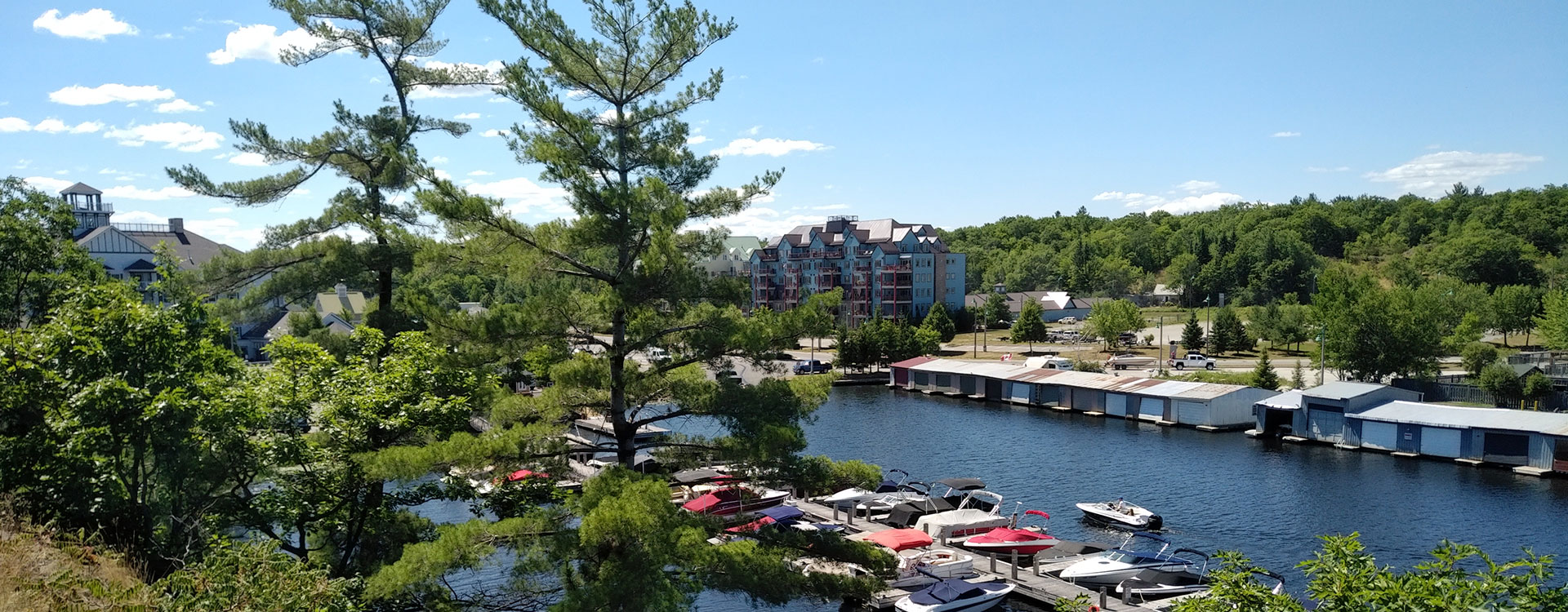 Muskoka Wharf Marina, summertime picture with boats and appartments in the background